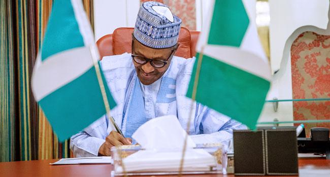 Buhari Signs N30,000 Minimum Wage Bill Into Law