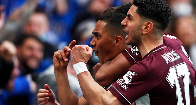 Leicester City's Belgian midfielder Youri Tielemans (L) celebrates scoring his team's first goal with Leicester City's Spanish striker Ayoze Perez (R) during the English FA Cup final football match between Chelsea and Leicester City at Wembley Stadium in north west London on May 15, 2021. MATTHEW CHILDS / POOL / AFP