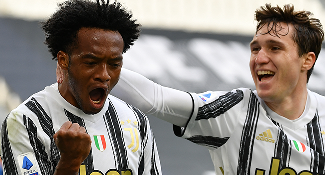 Juventus' Colombian midfielder Juan Cuadrado celebrates after scoring his first goal during the Italian Serie A football match Juventus vs Inter on May 15, 2021 at the Juventus stadium in Turin. Isabella BONOTTO / AFP