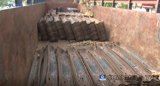 Vandal ised rail tracks materials are loaded on trucks for transport in Nasarawa.