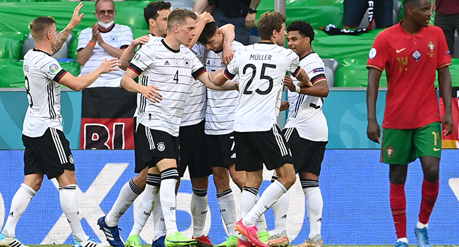 Germany's players celebrate scoring their team's third goal during the UEFA EURO 2020 Group F football match between Portugal and Germany at Allianz Arena in Munich, Germany, on June 19, 2021. CHRISTOF STACHE / POOL / AFP